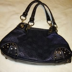 Kathy Van Zeeland black bag.